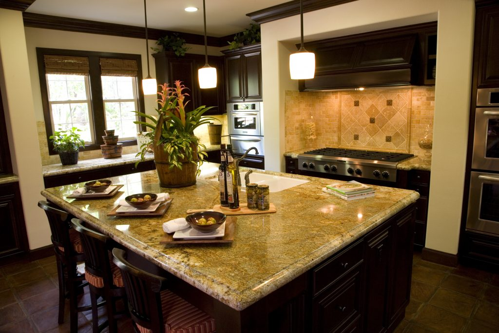 Custom kitchen with dark wood and marble