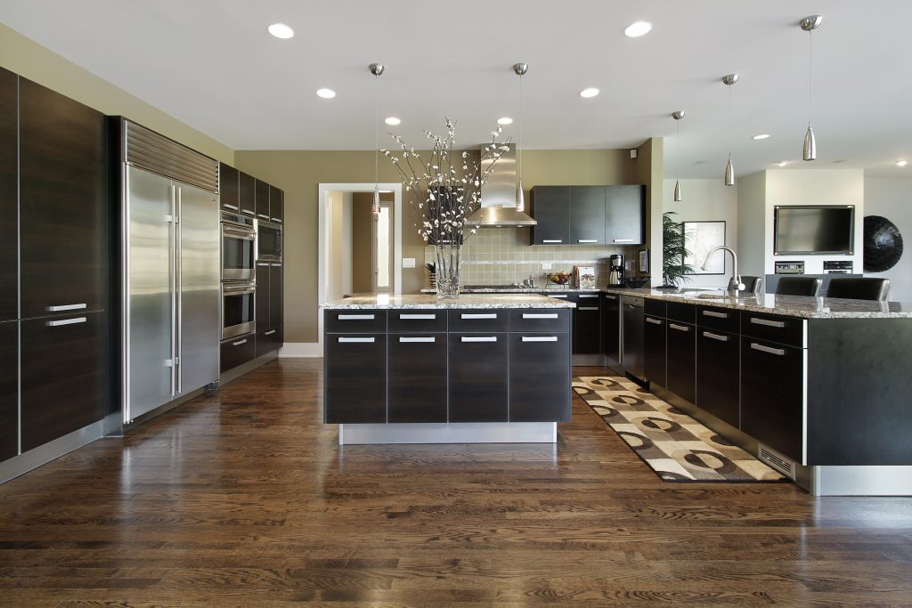 Custom kitchen remodeling with dark gray cabinets