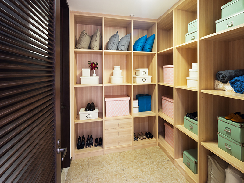 Wall Of Custom Shelving In Custom Closet