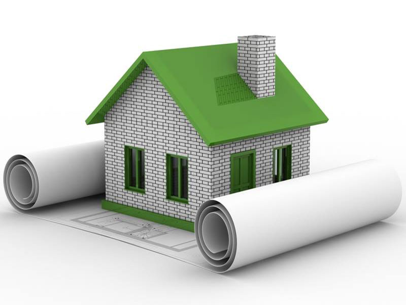 3D model of green home construction with blue prints in Jacksonville FL